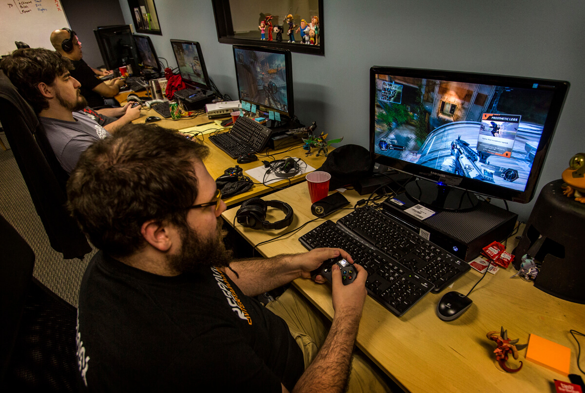 """***SUNDAY CALENDAR STORY FOR MARCH 9, 2014. DO NOT USE PRIOR TO PUBLICATION*** VAN NUYS, CA - FEBRUARY 27, 2014 - QA testers, including Mark Grimenstein, front, testing the new video game """"Titanfall"""" at Respawn Entertainment video game development studio, Thursday, February 27, 2014. The studio is launching the new video game on March 11, 2014. (Ricardo DeAratanha/Los Angeles Times)."""