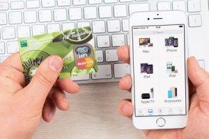 SIMFEROPOL, RUSSIA - JANUARY 10, 2015: Apple Store application on Apple iPhone 6 display over Macbook keyboard. The Apple Store is the online store of Apple Inc.